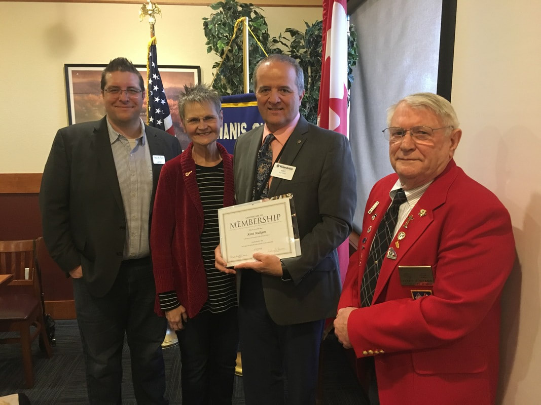 Dr. Kent Kultgen is introduced as a member of the Kiwanis Club of Snohomish by President Melody Dana and Board members Rod Vroman and Jared Burns